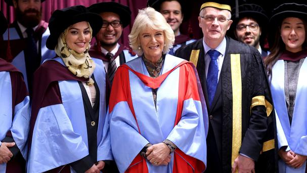 The Duchess Of Cornwall at the University of Southampton with Vice Chancellor Professor Sir Christopher Snowden and graduates after she was awarded an honorary doctorate
