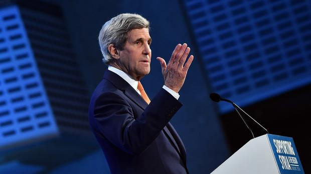 US Secretary of State John Kerry announced diplomats meeting at a summit in Munich have agreed to implement