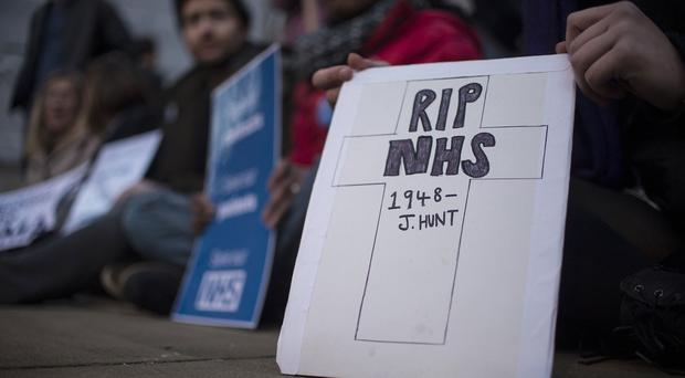 Protests outside the Department of Health in London after Jeremy Hunt announced he would impose a new contract on thousands of junior doctors