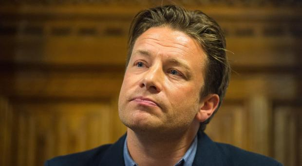 Jamie Oliver says raising the prices of sugar-laden fizzy drinks and snacks is the best way to cut consumption