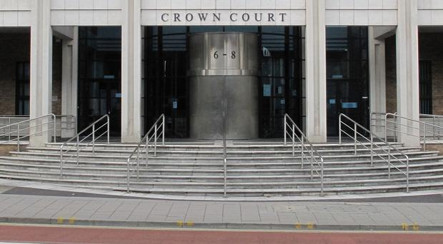 Junead Khan is on trial at Kingston Crown Court charged with making preparations for attacking military personnel in the UK
