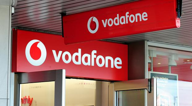 Mobile phone giant Vodafone has sealed a deal with cable firm Liberty Global to merge their Dutch businesses