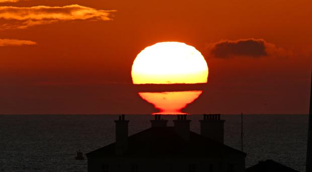 The sun rises over St Mary's Island in Whitley Bay, as people in different parts of the country are told to expect varying weather
