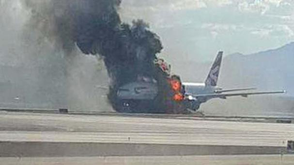A British Airways Boeing 777-200 burst into flames at McCarran International Airport, Las Vegas (Eric Hays / PA)