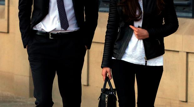 Footballer Adam Johnson leaves court with partner Stacey Flounders yesterday