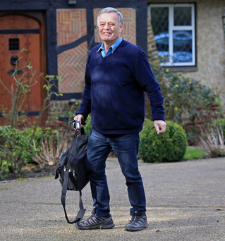 Veteran DJ Tony Blackburn arrives at his home in Hertfordshire yesterday after he accused the BBC of making him a scapegoat