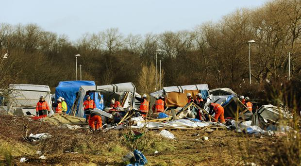 Demolition continues at the Calais migrant camp known as the Jungle, in northern France