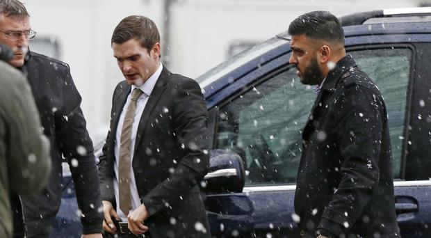 Footballer Adam Johnson (white shirt) arrives at Bradford Crown Court where he is on trial accused of sexual activity with a child