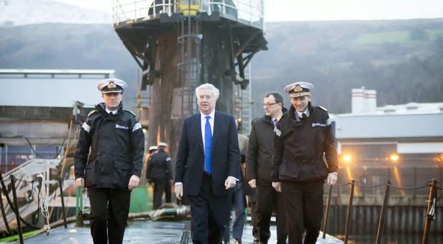 Defence Secretary Michael Fallon will tell MPs he is pressing ahead with work to replace the four ageing Vanguard-class submarines