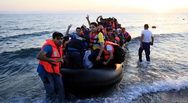 Prime minister David Cameron says returning migrants to Turkey would close the refugee trail through the Balkans