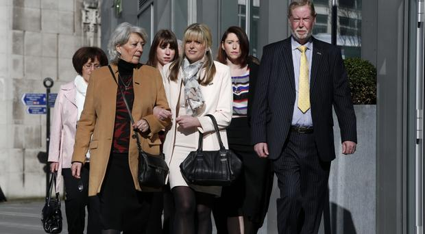 Jen Phillips, wife of Pc David Phillips, with his parents, Carol and Robin, arrive at Manchester Crown Court for the trial of Clayton Williams, who is charged with the officer's murder