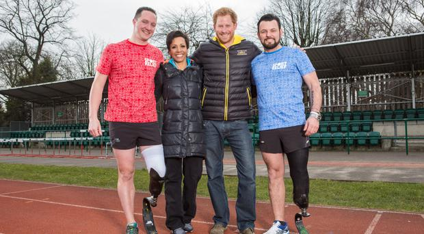 Dame Kelly Holmes and Prince Harry join a Sport Relief training session at Battersea Park, south London, to lend their support to competitors Paul Vice, right, and Mike Goody (Comic Relief/PA Wire)