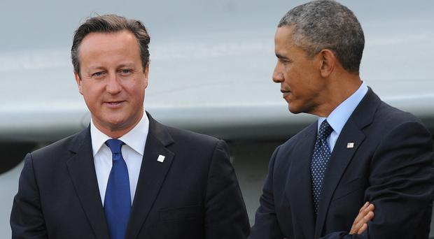 US president Barack Obama, right, said David Cameron became 'distracted' from Libya by other priorities