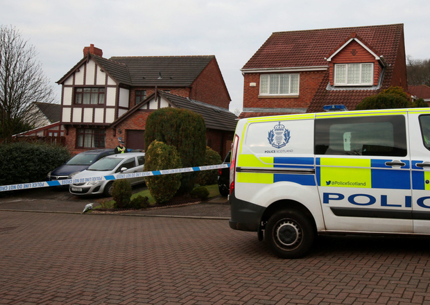 Police outside the house (left) where Rhys and Shaun Scott died. Photo: Andrew Milligan/PA Wire