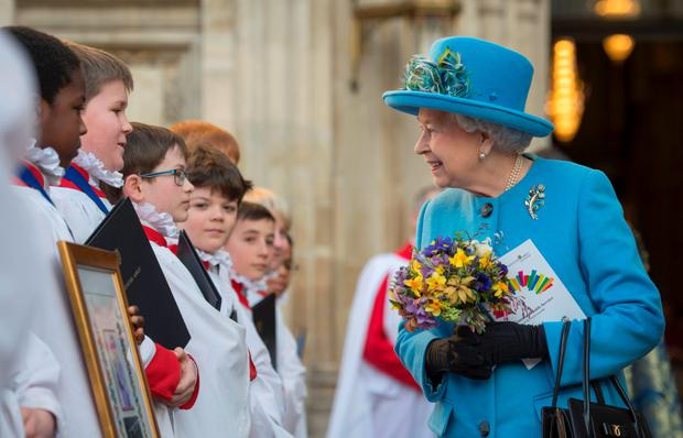 The Queen chats to some of the choristers before the service begins
