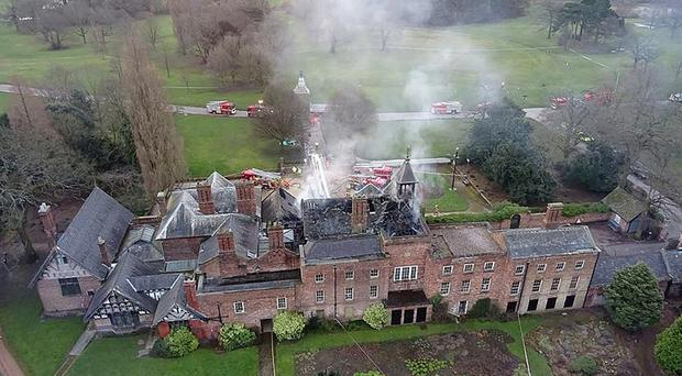 Emergency services at the scene of a fire at the 16th century Wythenshawe Hall in Manchester (Greater Manchester Fire and Rescue Service Air Unit Team/PA)