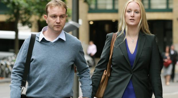Former city trader Tom Hayes and his wife Sarah Tighe as he could be forced to give up his seven-bedroom Surrey home