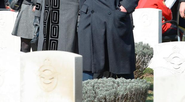 The Prince of Wales and Duchess of Cornwall at the Commonwealth War Graves Cemetery in Belgrade, Serbia, after arriving from Croatia, on the third day of their six day tour to the Balkans