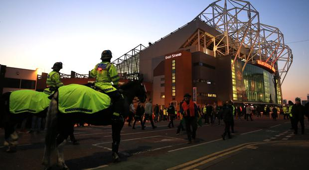 Police presence outside Old Trafford before the Europa League game between Manchester United and Liverpool