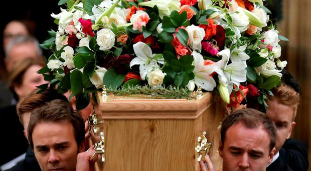 Actors Jack P Shepherd and Alan Halsall carry the coffin of Coronation Street creator Tony Warren at his funeral yesterday