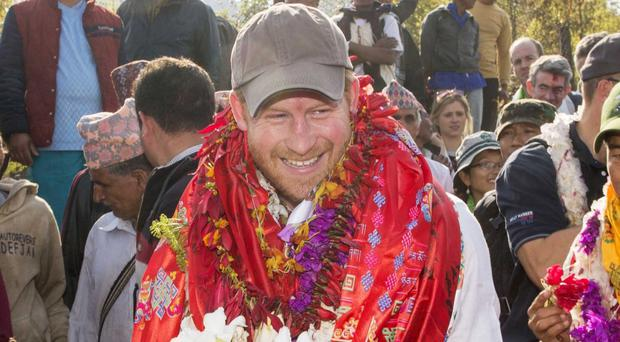 Prince Harry arrives at the Himalayan village of Okhari on day four of his visit to Nepal