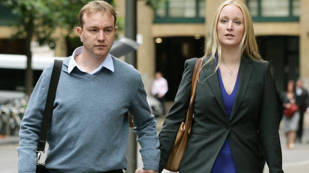 Tom Hayes, pictured with wife Sarah Tighe, will return to court to hear a senior judge rule on a Serious Fraud Office bid to seize more than £2 million of his assets