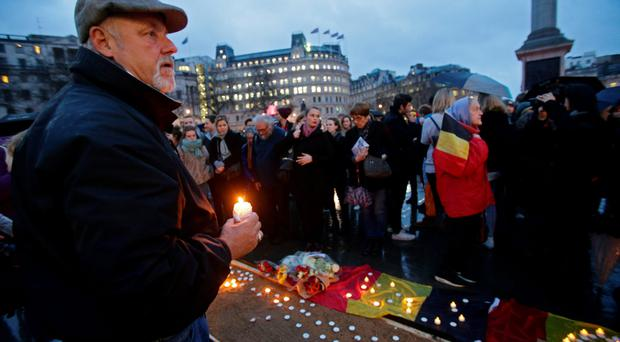 People gather for a vigil in Trafalgar Square, London, to pay tribute to the victims of the terror attacks in Brussels