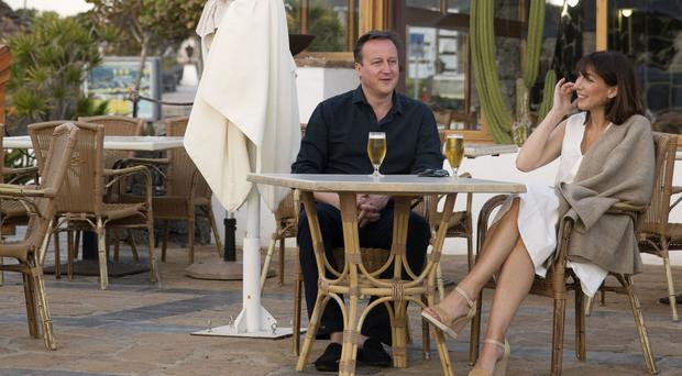 Prime Minister David Cameron and his wife Samantha during their holiday in Playa Blanca, Lanzarote