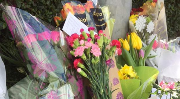 Flowers and messages left after shopkeeper Asad Shah died following an attack outside his premises in Minard Road, Glasgow