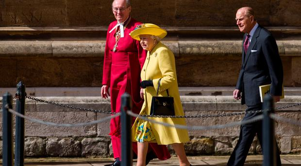 Queen with Dean of Windsor David Conner and Prince Philip as they leave the Easter Sunday service at St George's Chapel