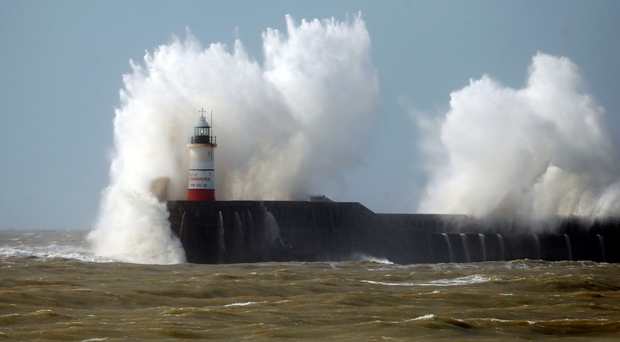 Waves batter the lighthouse at Newhaven in East Sussex where Storm Katie brought high winds and choppy waters