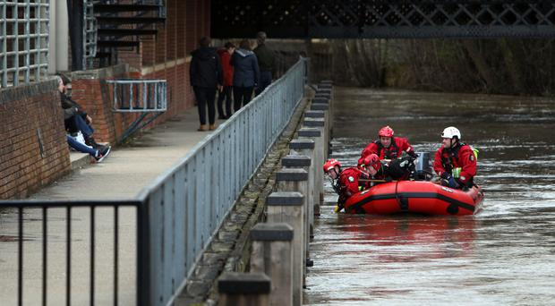 Searches underway on the River Wey in Guildford, Surrey, after police officers were called near to the Guildford Borough Council offices, after receiving reports a man had gone into the water.