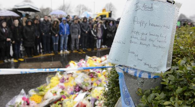 Floral tributes for Asad Shah