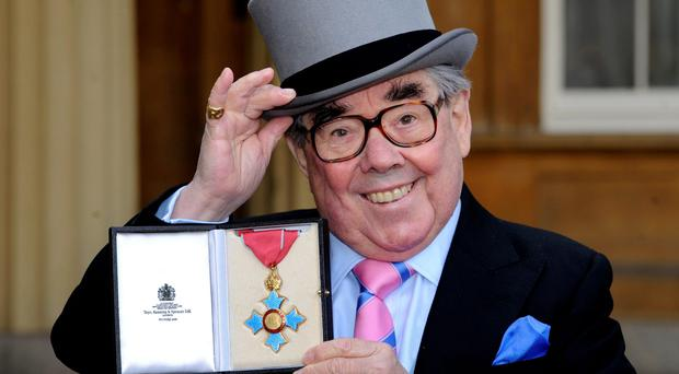 Ronnie Corbett with the CBE he received from the Queen in 2012