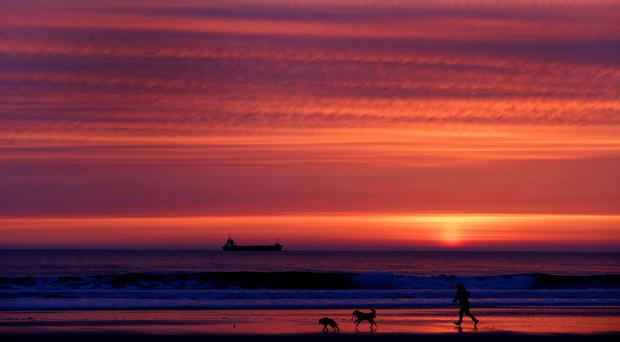 The sun rises above Tynemouth Longsands beach, as the UK looks set to enjoy a period of warmer weather