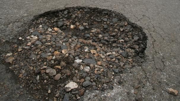 Funding for pothole repairs has been cut by local authorities