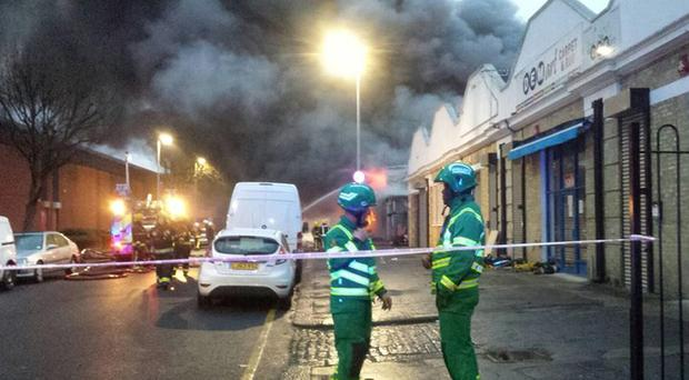 Emergency personnel attending the blaze at an industrial bakery in Tottenham, north London.