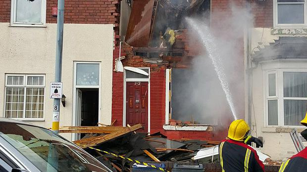 The terraced home was reduced to a smoking ruin after the blast (West Midlands Fire Service/PA Wire)
