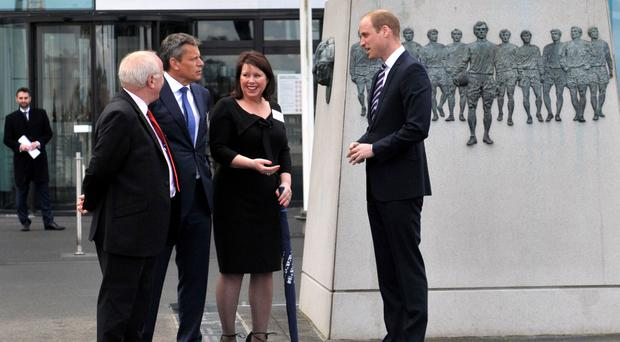 The Duke of Cambridge, right, is greeted underneath the Sir Bobby Moore statue at Wembley Stadium by Football Association chairman Greg Dyke, left, and FA colleagues Martin Glenn and Julie Harrington