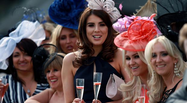 Racegoers during Ladies Day of the Crabbie's Grand National Festival at Aintree Racecourse, Liverpool