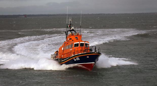A lifeboat and helicopter remain at the scene so the search can continue