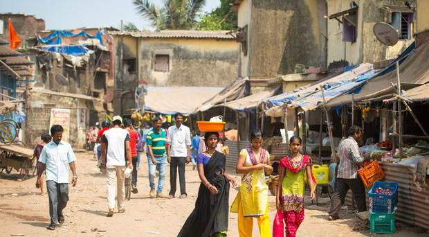 People walking in the streets of the Ambedkar Nagar slum area in Mumbai, India