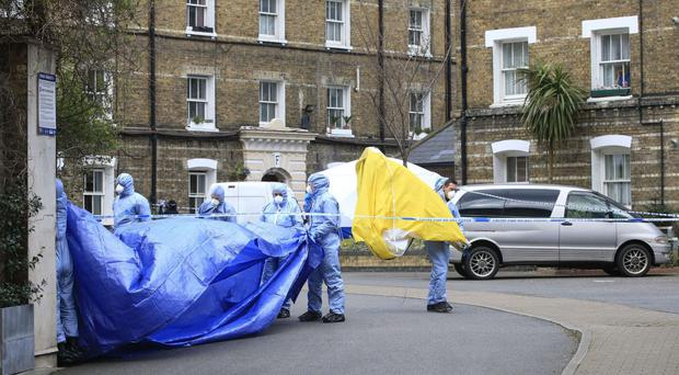 Forensic officers at the estate where the remains of Pc Gordon Semple were found