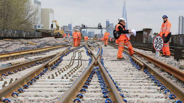 Network Rail's 'orange army' of engineers will be working over the May Day bank holiday weekend (Network Rail/PA)