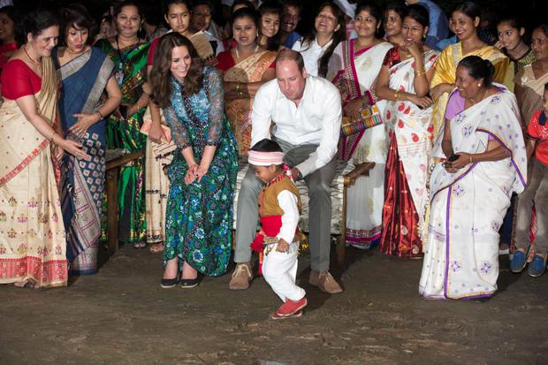 The Duchess in flowing maxi dress while she and her husband William watch dancers during the Bihu Festival