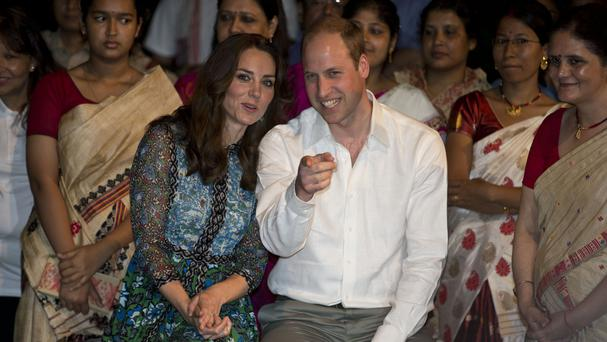 Kate and William watch dancers during the Bihu Festival celebration in Assam, India