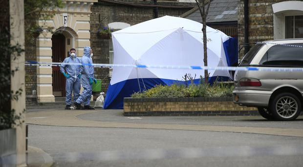 Police forensic officers near the Great Guildford Street entrance to the Peabody Estate in south London
