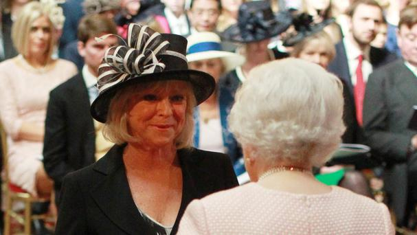 Sue Barker receives her OBE from the Queen