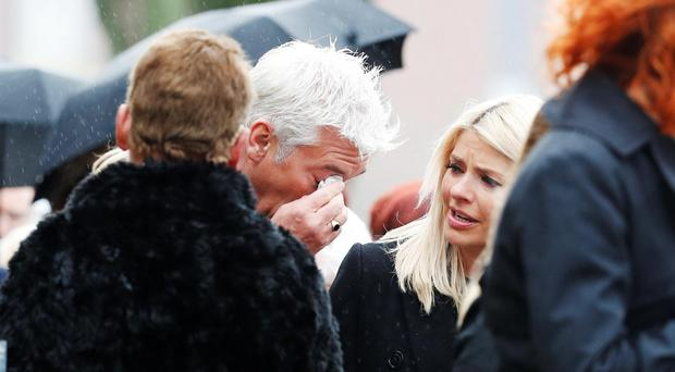 This Morning presenter Phillip Schofield wipes his eye as Holly Willoughby looks on following the funeral of TV agony aunt Denise Robertson Sunderland Minster