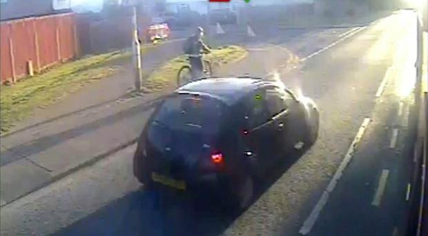 A black Ford Ka moments after it knocked a woman over when it failed to stop at a pedestrian crossing on in Dagenham (Metropolitan Police/PA)